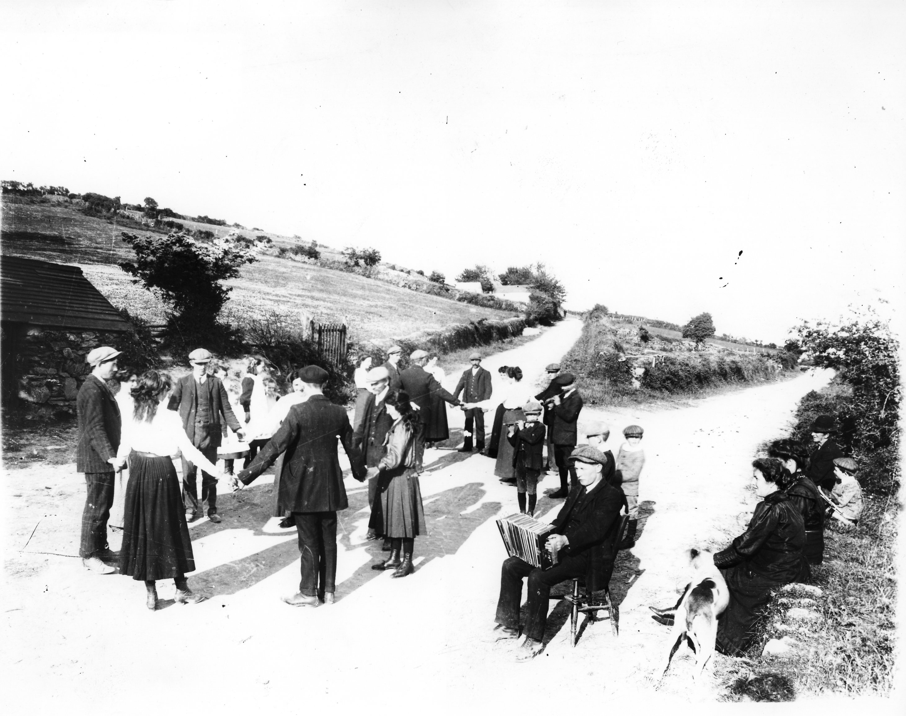 Locate this photo in the NUI Galway library archives at  http://archives.library.nuigalway.ie/joeburke/images/DancingCrossroads1891.jpg